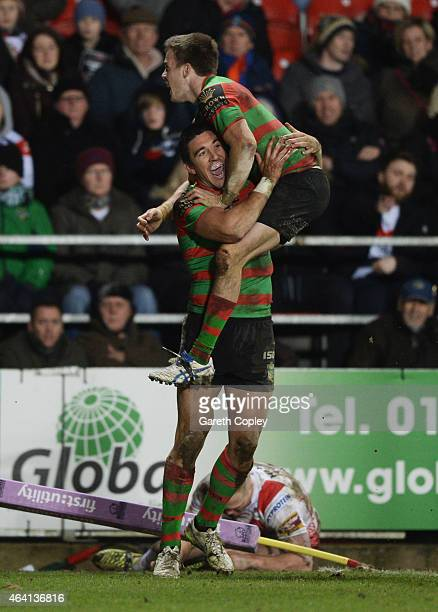 Joel Reddy of South Sydney Rabbitohs celebrates as he scores their seventh try with team mate Luke Keary during the World Club Challenge match...