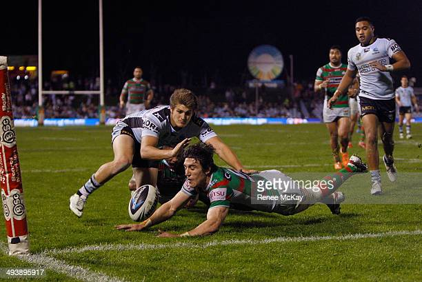 Joel Reddy of the Rabbitohs bats the ball out of play during the round 11 NRL match between the Cronulla-Sutherland Sharks and the South Sydney...