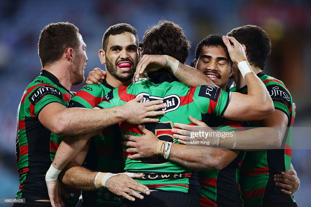 Joel Reddy (C) of the Rabbitohs celebrates with Greg Inglis (L) and Kirisome Auva'a (R) after scoring a try during the round 12 NRL match between the South Sydney Rabbitohs and the St George Illawarra Dragons at ANZ Stadium on June 2, 2014 in Sydney, Australia.