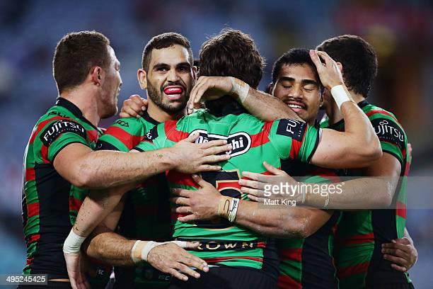 Joel Reddy of the Rabbitohs celebrates with Greg Inglis and Kirisome Auva'a after scoring a try during the round 12 NRL match between the South...