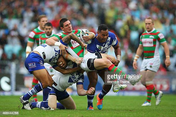 Joel Reddy of the Rabbitohs is tackled by is tackled by the Bulldogs defence during the round five NRL match between the Canterbury Bulldogs and the...