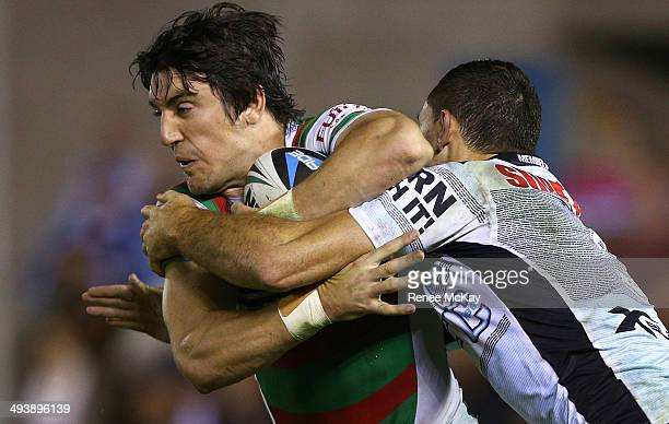 Joel Reddy of the Rabbitohs is tackled by Jonathan Wright during the round 11 NRL match between the Cronulla-Sutherland Sharks and the South Sydney...