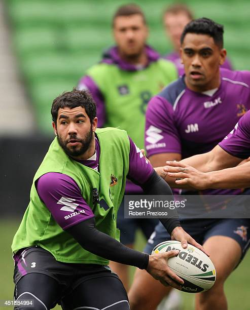 Joel Romelo prepares to offload the ball during a Melbourne Storm NRL training session at AAMI Park on July 9 2014 in Melbourne Australia