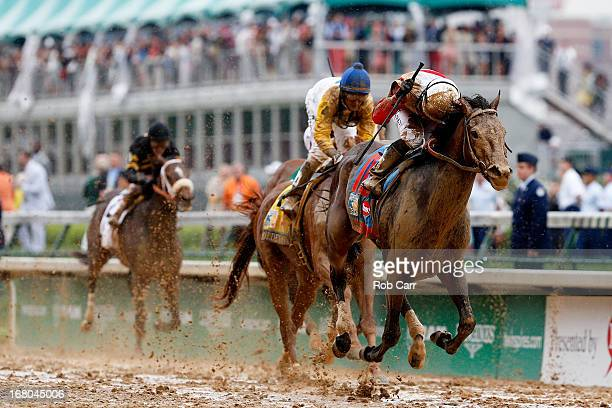 Joel Rosario atop Orb reacts after winning the 139th running of the Kentucky Derby at Churchill Downs on May 4 2013 in Louisville Kentucky