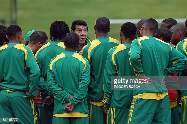 Joel Santana , newly appointed coach of the South African football team known as Bafana Bafana, speaks to the team during their first practice...