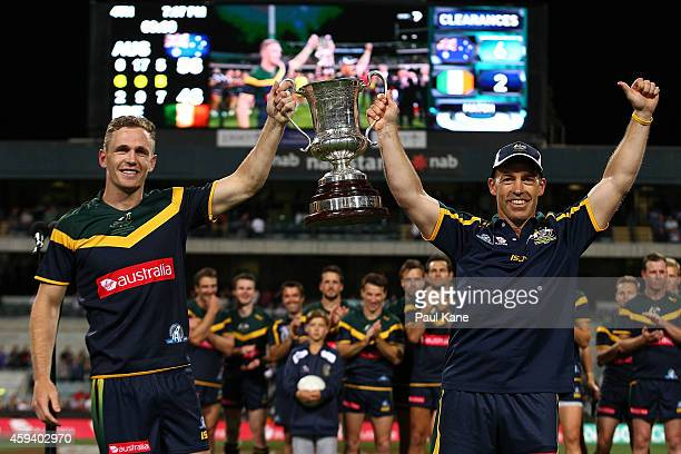 Joel Selwood and Alastair Clarkson head coach of Australia hold the Cormac McAnallen Cup after winning the International Rules Test Match between...