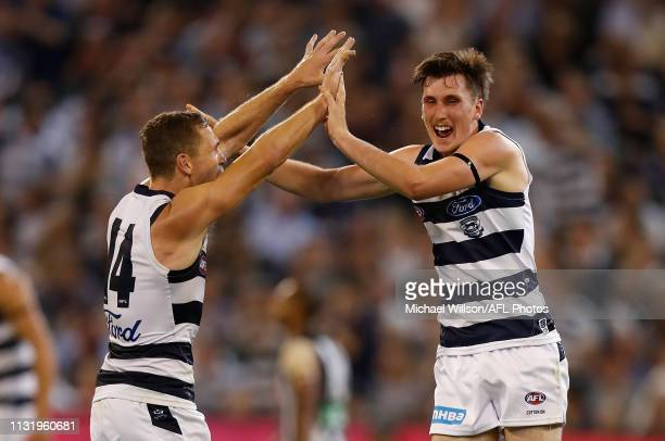 Joel Selwood and Charlie Constable of the Cats celebrate during the 2019 AFL round 01 match between the Collingwood Magpies and the Geelong Cats at...