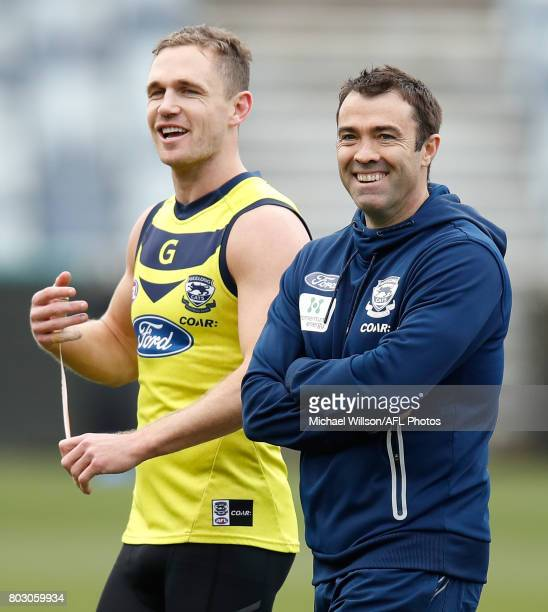 Joel Selwood and Chris Scott Senior Coach of the Cats share a laugh during a Geelong Cats AFL training session at Simonds Stadium on June 29 2017 in...
