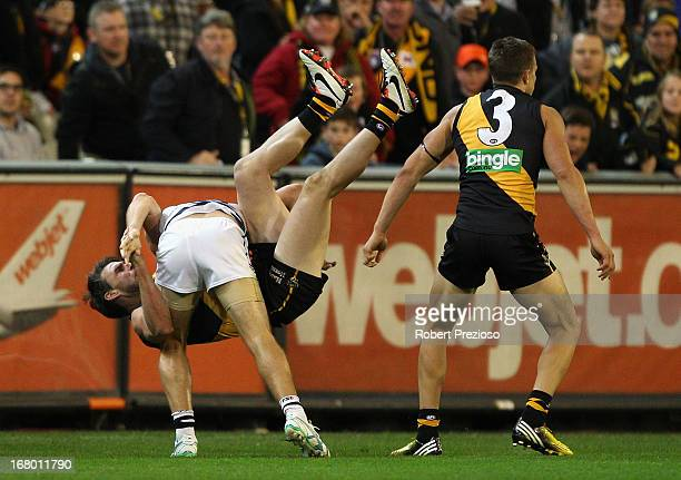 Joel Selwood of the Cats and Chris Newman of the Tigers wrestle during the round six AFL match between the Richmond Tigers and the Geelong Cats at...