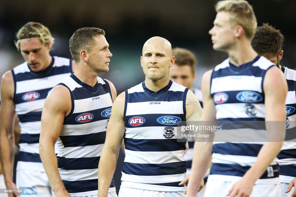 Joel Selwood of the Cats (L) and Gary Ablett look dejected walking off after defeat during the round two AFL match between the Geelong Cats and the Hawthorn Hawks at Melbourne Cricket Ground on April 2, 2018 in Melbourne, Australia.