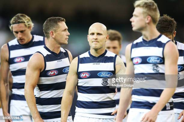 Joel Selwood of the Cats and Gary Ablett look dejected walking off after defeat during the round two AFL match between the Geelong Cats and the...