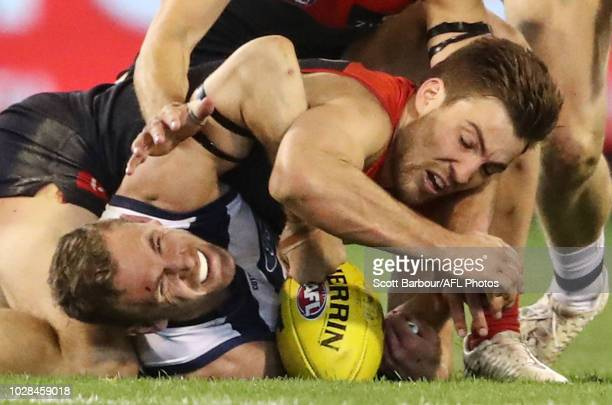 Joel Selwood of the Cats and Jack Viney of the Demons compete for the ball during the AFL First Elimination Final match between the Melbourne Demons...