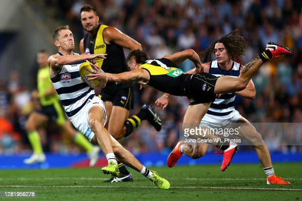 Joel Selwood of the Cats breaks from a tackle from Liam Baker of the Tigers during the 2020 AFL Grand Final match between the Richmond Tigers and the...