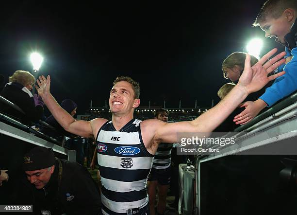 Joel Selwood of the Cats celebrates after the Cats defeated the Swans during the round 19 AFL match between the Geelong Cats and the Sydney Swans at...