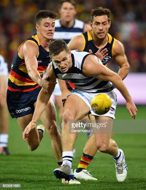 Joel Selwood of the Cats competes for the ball during the round 18 AFL match between the Adelaide Crows and the Geelong Cats at Adelaide Oval on July...