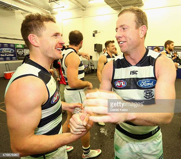 Joel Selwood of the Cats congratulates Steve Johnson of the Cats after the round 11 AFL match between the Port Adelaide Power and the Geelong Cats at...