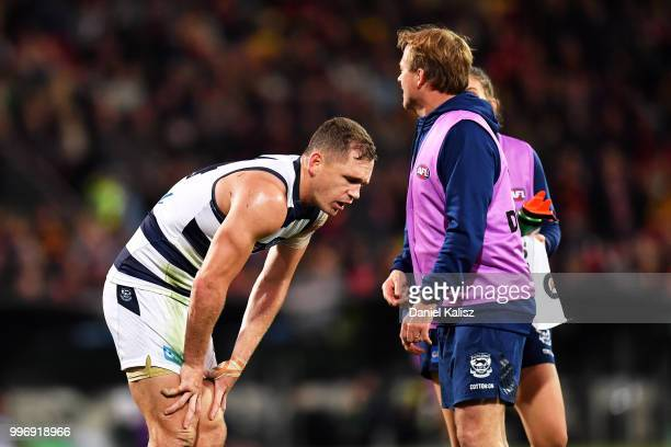 Joel Selwood of the Cats is attended to by trainers during the round 17 AFL match between the Adelaide Crows and the Geelong Cats at Adelaide Oval on...