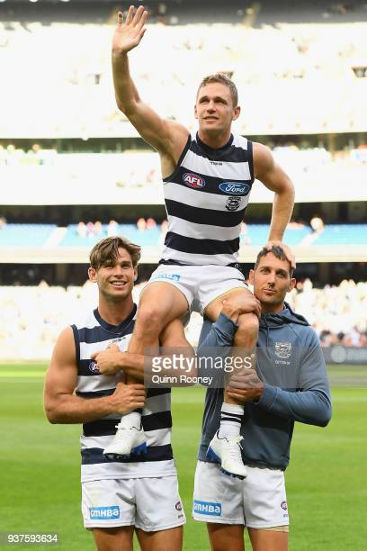 Joel Selwood of the Cats is chaired off the ground in game 250 during the round one AFL match between the Melbourne Demons and the Geelong Cats at...