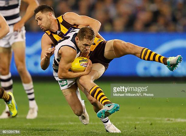 Joel Selwood of the Cats is tackled by Jack Gunston of the Hawks during the 2016 AFL Second Qualifying Final match between the Geelong Cats and the...
