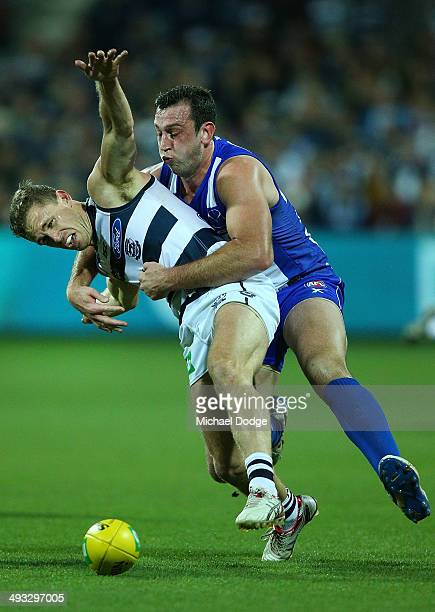 Joel Selwood of the Cats is tackled by Todd Goldstein of the Kangaroos during the round 10 AFL match between the Geelong Cats and the North Melbourne...