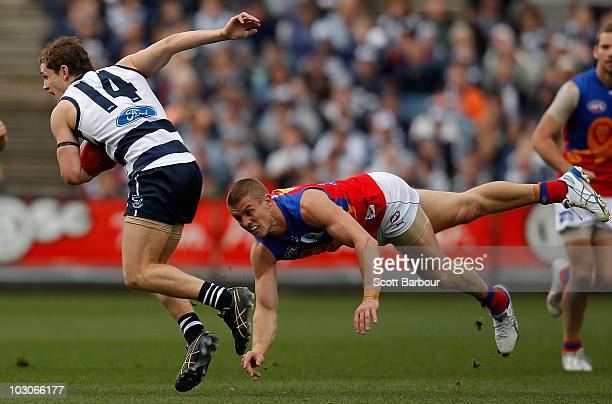 Joel Selwood of the Cats is tackled during the round 17 AFL match between the Geelong Cats and the Brisbane Lions at Skilled Stadium on July 24, 2010...