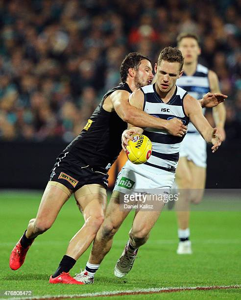 Joel Selwood of the Cats kicks an is tackled by Travis Boak of the Power during the round 11 AFL match between the Port Adelaide Power and the...