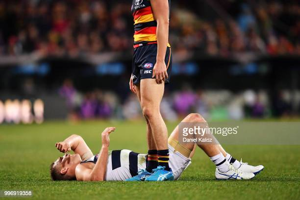 Joel Selwood of the Cats lays on the ground after receiving heavy contact during the round 17 AFL match between the Adelaide Crows and the Geelong...