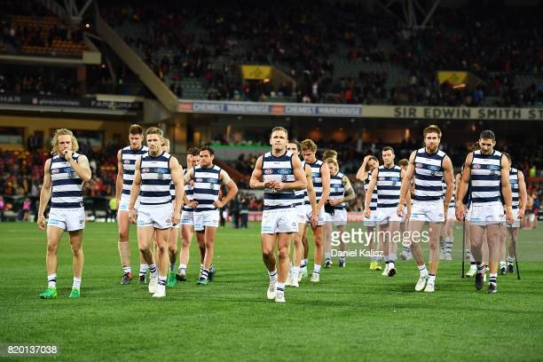 Joel Selwood of the Cats leads his team from the field after being defeated by the Crows during the round 18 AFL match between the Adelaide Crows and...