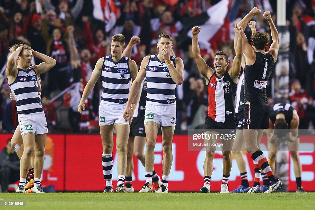 Joel Selwood of the Cats looks dejected as Darren Minchington of the Saints (R) celebrates the win on the siren during the round 14 AFL match between the St Kilda Saints and the Geelong Cats at Etihad Stadium on June 25, 2016 in Melbourne, Australia.