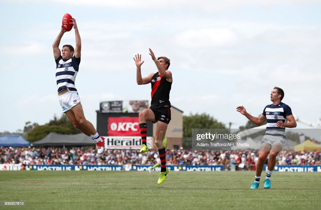Joel Selwood of the Cats marks the ball ahead of Joe Daniher of the Bombers during the AFL 2018 JLT Community Series match between the Geelong Cats and the Essendon Bombers at Central Reserve on March 11, 2018 in Colac, Australia.