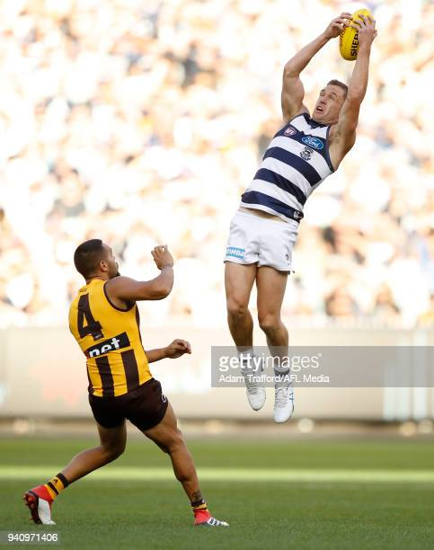 Joel Selwood of the Cats marks the ball over Jarman Impey of the Hawks during the 2018 AFL round 02 match between the Geelong Cats and the Hawthorn...