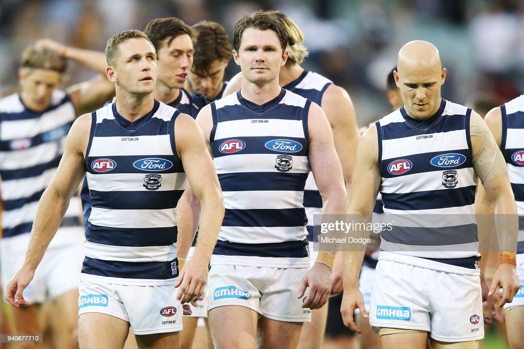 Joel Selwood of the Cats (L) Patrick Dangerfield (C) and Gary Ablett looks dejected walking off after defeat during the round two AFL match between the Geelong Cats and the Hawthorn Hawks at Melbourne Cricket Ground on April 2, 2018 in Melbourne, Australia.