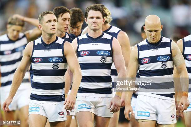 Joel Selwood of the Cats Patrick Dangerfield and Gary Ablett looks dejected walking off after defeat during the round two AFL match between the...