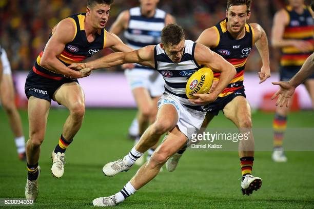 Joel Selwood of the Cats runs with the bal during the round 18 AFL match between the Adelaide Crows and the Geelong Cats at Adelaide Oval on July 21...
