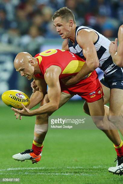 Joel Selwood of the Cats tackles Gary Ablett of the Suns during the round six AFL match between the Geelong Cats and the Gold Coast Suns at Simonds...