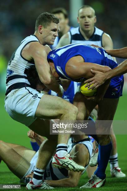 Joel Selwood of the Cats tackles Michael Firrito of the Kangaroos during the round 10 AFL match between the Geelong Cats and the North Melbourne...