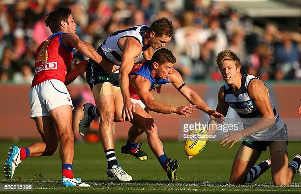 Joel Selwood of the Geelong Cats and Dayne Zorko of the Lions compete for the ball during the round three AFL match between the Geelong Cats and the...