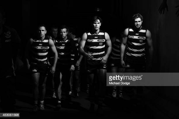Joel Selwood Steve Johnson Tom Hawkins and Dawson Simpson of the Cats walk out after half time during the round 19 AFL match between the North...