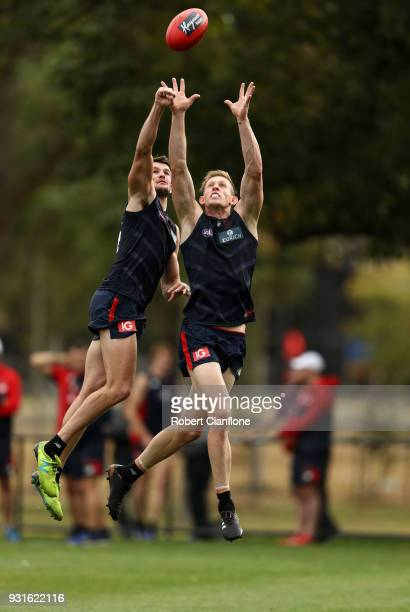 Joel Smith and Sam Frost of the Demons compete for the ball during a Melbourne Demons AFL training session at Gosch's Paddock on March 14 2018 in...