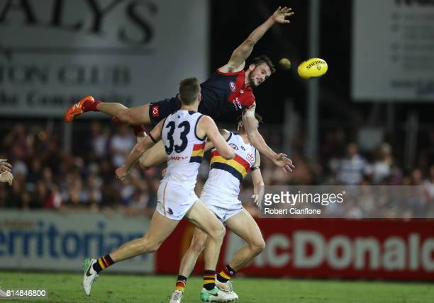 Joel Smith of the Demons leaps for the ball during the round 17 AFL match between the Melbourne Demons and the Adelaide Crows at TIO Stadium on July...