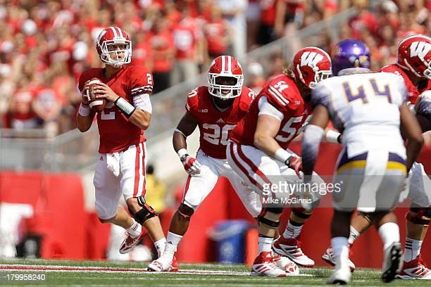 Joel Stave of the Wisconsin Badgers drops back to pass the football during the game against the Tennessee Tech Golden Eagles at Camp Randall Stadium...