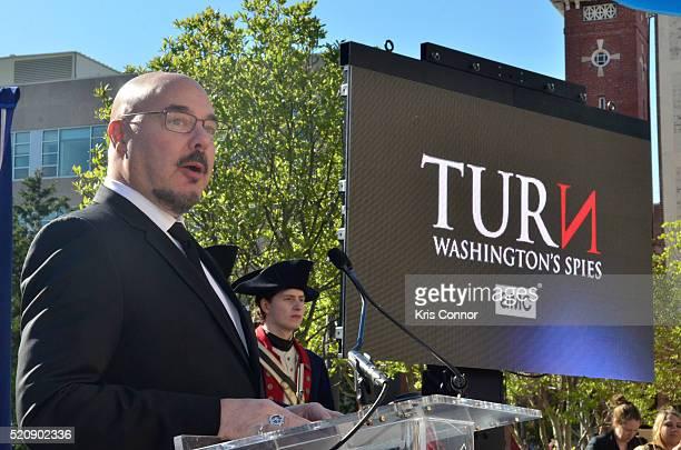 Joel Stillerman speaks during the TURN Washington Spies DC Key Art Unveiling at Kogan Plaza on The George Washington University campus on April 13...
