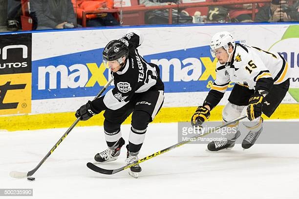 Joel Teasdale of the BlainvilleBoisbriand Armada skates the puck against Alexandre Gosselin of the Cape Breton Screaming Eagles during the QMJHL game...
