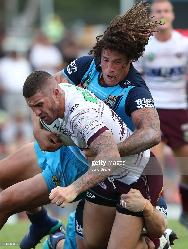 Joel Thompson of Manly is tackled by Kevin Proctor of the Titans during the round five NRL match between the Gold Coast Titans and the Manly Sea Eagles at Marley Brown Oval on April 8, 2018 in Gladstone, Australia.