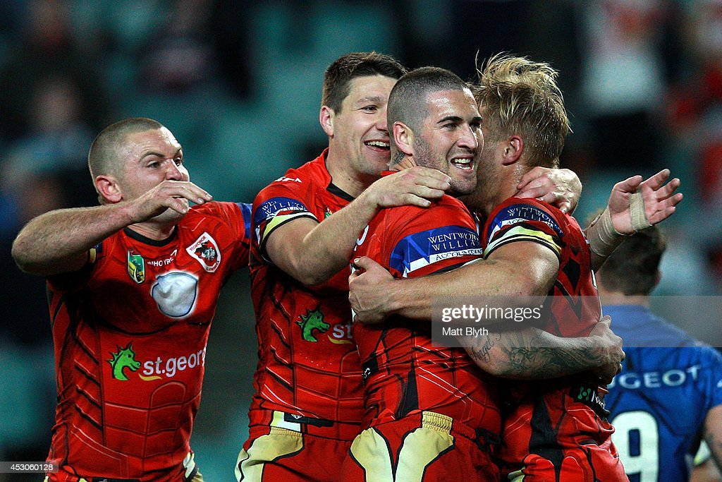 Joel Thompson of the Dragons celebrates with team mates after scoring a try during the round 21 NRL match between the Sydney Roosters and the St George Illawarra Dragons at Allianz Stadium on August 2, 2014 in Sydney, Australia.