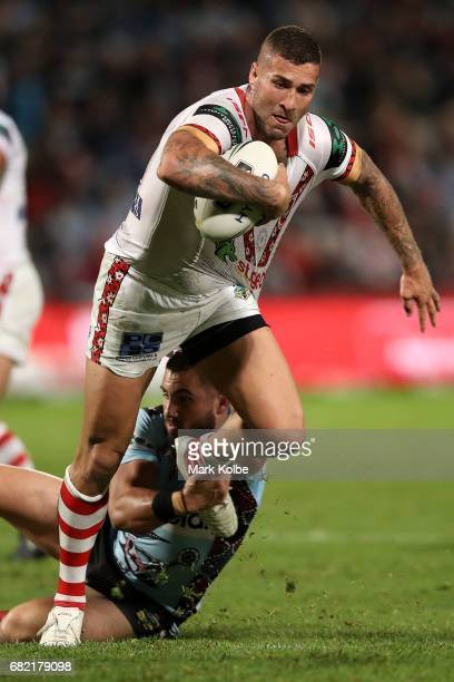 Joel Thompson of the Dragons is tackled by Jack Bird of the Sharks during the round 10 NRL match between the St George Illawarra Dragons and the...