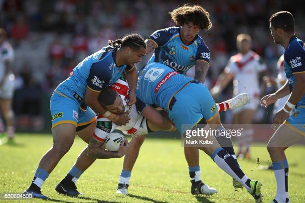 Joel Thompson of the Dragons is tackled during the round 23 NRL match between the St George Illawarra Dragons and the Gold Coast Titans at UOW...