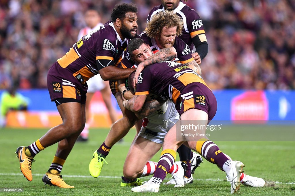 Joel Thompson of the Dragons is tackled during the round 24 NRL match between the Brisbane Broncos and the St George Illawarra Dragons at Suncorp Stadium on August 18, 2017 in Brisbane, Australia.