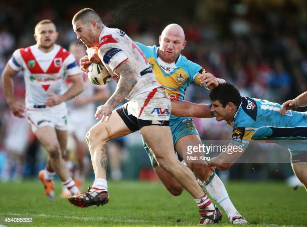 Joel Thompson of the Dragons takes on the defence during the round 24 NRL match between the St George Illawarra Dragons and the Gold Coast Titans at...