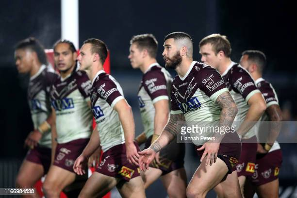 Joel Thompson of the Sea Eagles and his team look on during the round 21 NRL match between the New Zealand Warriors and the Manly Warringah Sea...
